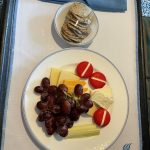 Room service has no charge on Disney Cruise Line. You can get an amazing cheese plate delivered to your door